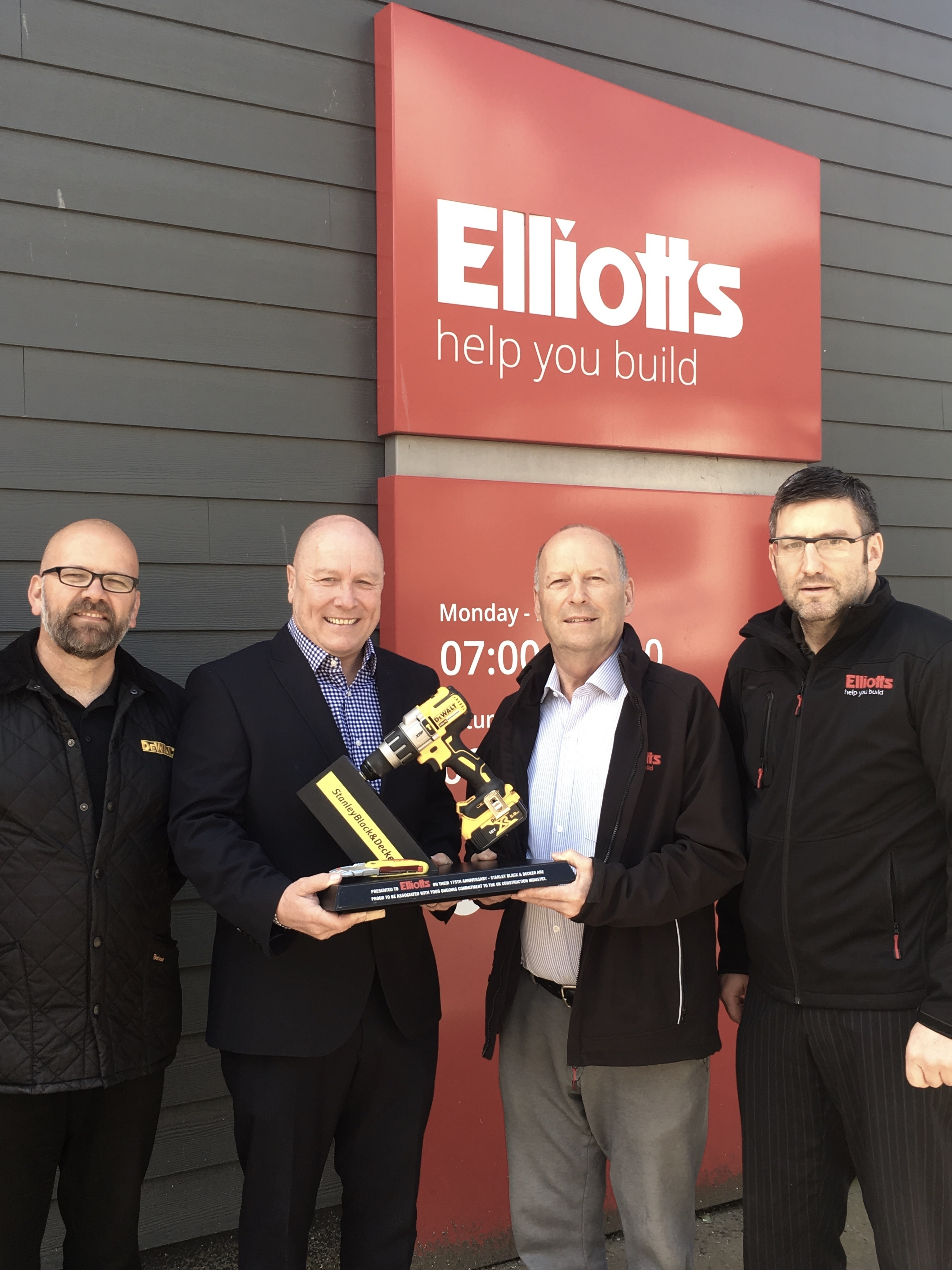 DeWalt's General Sales Manager, Mick Gill, presents a 175th anniversary commemorative trophy to Elliotts Chariman, Stuart Mason-Elliott