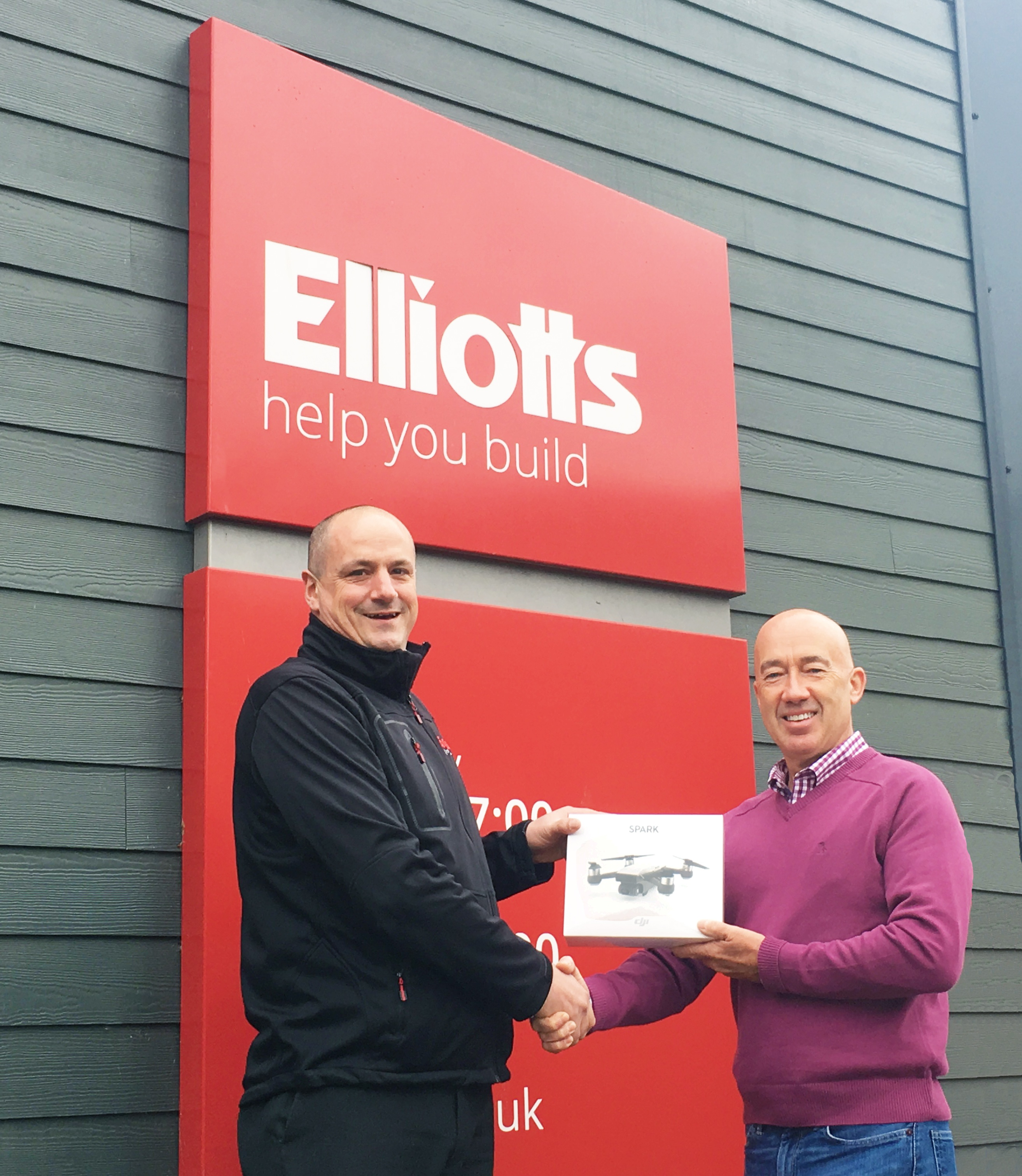 Paul Humphreys receiving his drone from Steve Thomas