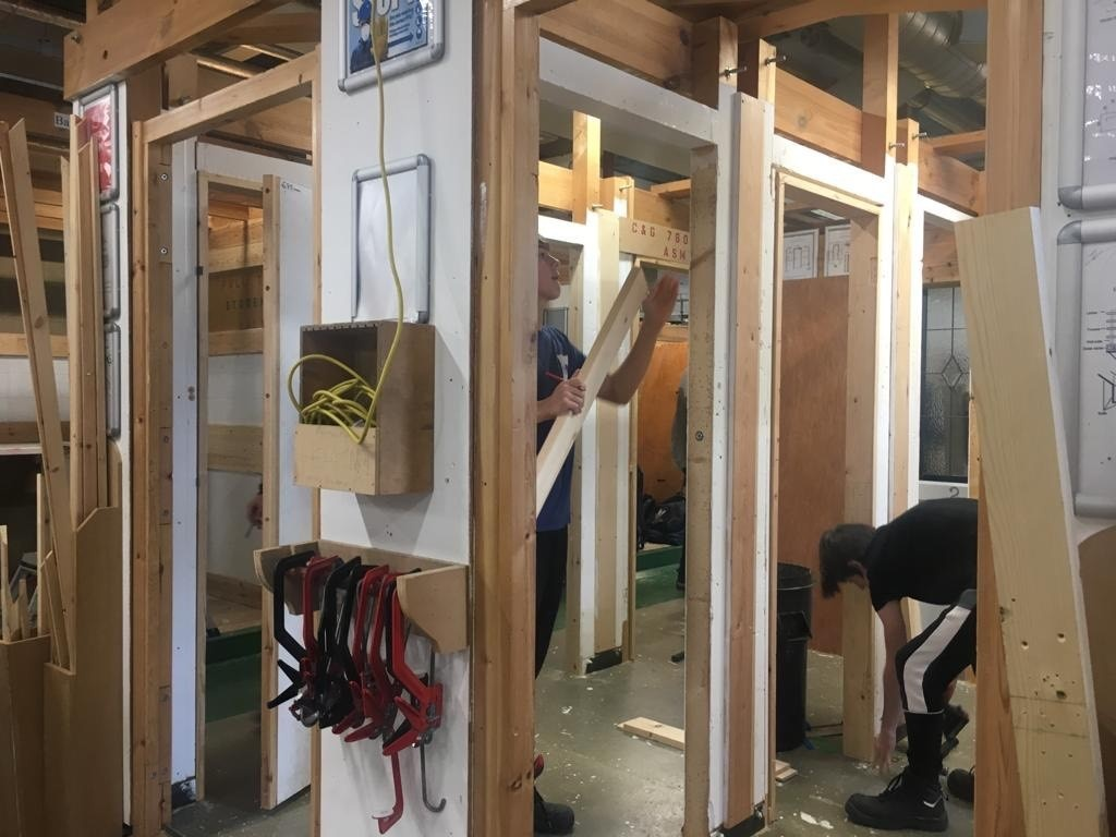 City College students at work with the internal doors donated by Elliotts