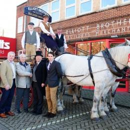 Tom Elliott and Stuart Mason-Elliott with longstanding customers, the Hammonds, outside head office